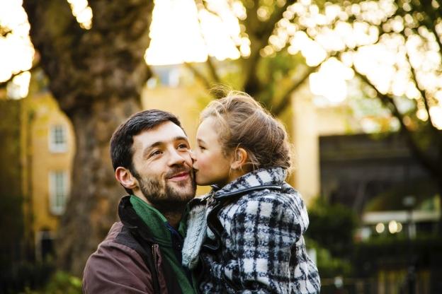 Daughter Kisses Dad Cheek