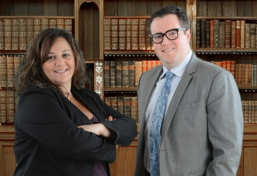 Denise M. Resta-Tobin, Esq., and Alexander W. Dunshee, Esq., founding partners.